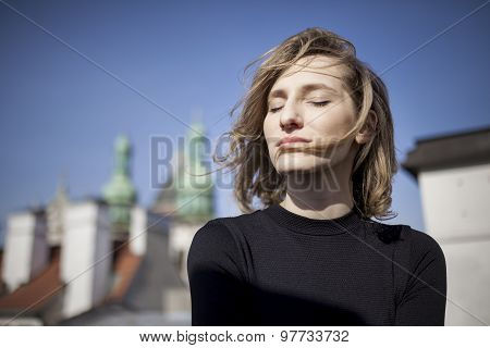 Beautiful woman with a happy expression on her face looking straight ahead
