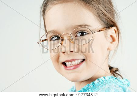 Little Blond Girl With Glasses