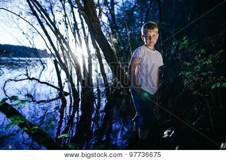 little boy on swamp