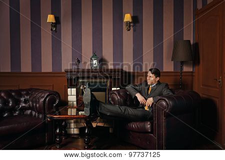 Businessman Relaxing While Sitting In A Leather Executive Chair.