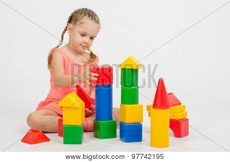Girl Collects House Of Cubes