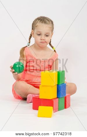 The Child Does Not Know Where To Put Ball In House