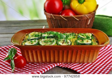 Casserole with vegetable mallow on wooden table table on light background