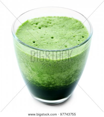 Glass of green vegetable juice isolated on white