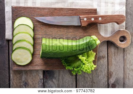 Fresh zucchini with squash on cutting board