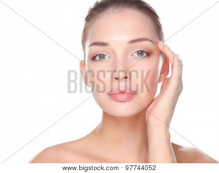 Beautiful healthy woman touching her skin.