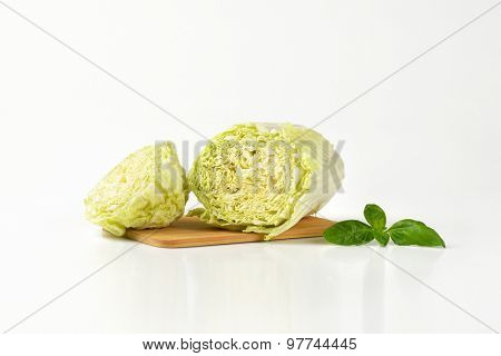 halved chinese cabbage on wooden cutting board