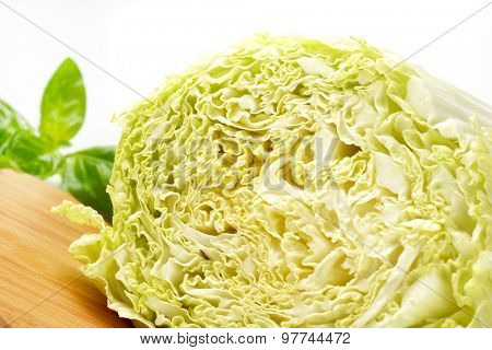 detail of halved chinese cabbage on wooden cutting board