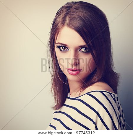 Beautiful Makeup Young Woman With Pink Lipstick And Vamp Look. Toned Closeup Portrait