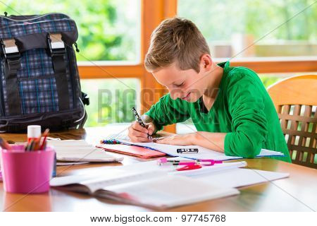 Student doing homework assignment for school at home