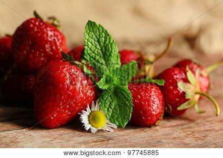 Red ripe strawberries, on wooden background