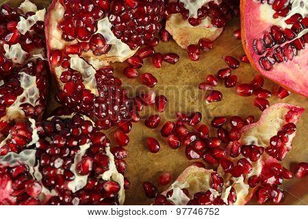 Pomegranate seeds on metal tray, closeup