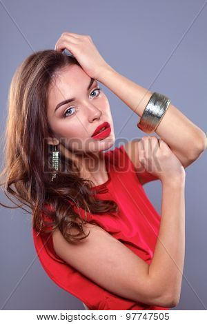 Young beauty woman in red dress .