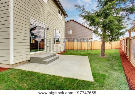Luxury Back Yard With Unfurnished Patio And Grass.