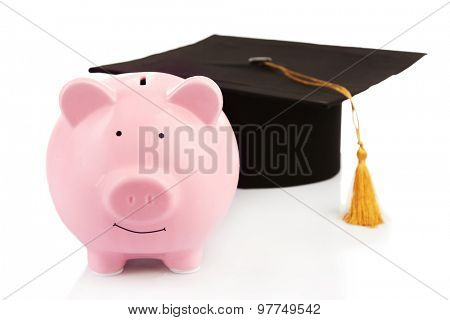 Pink piggy bank with Graduation hat isolated on white