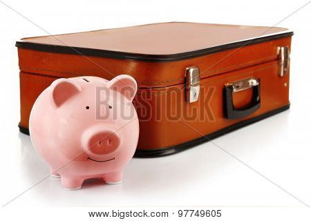 Pink piggy bank with suitcase isolated on white