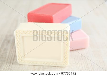 Bars of natural soap on light background