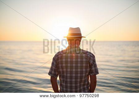 man standing backlight sunset lighting, back view