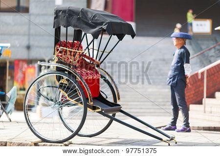 Japanese rickshaw man awaiting for the customers.
