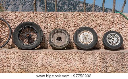 Small old rusty moto wheel.