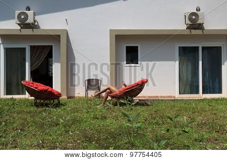 Large Backyard With A Lawn And Chairs