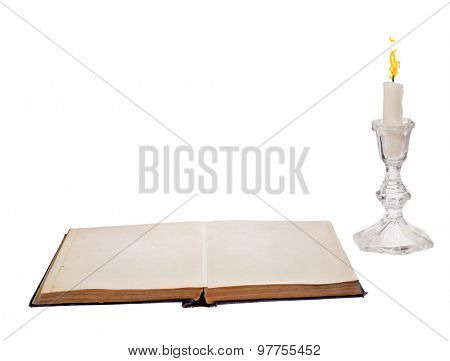 open blank book and candle isolated on white background
