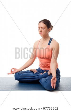 Beautiful fit yogini woman meditating  in yoga asana Padmasana (Lotus pose) cross legged position for meditation with Chin Mudra - psychic gesture of consciousness isolated on white background