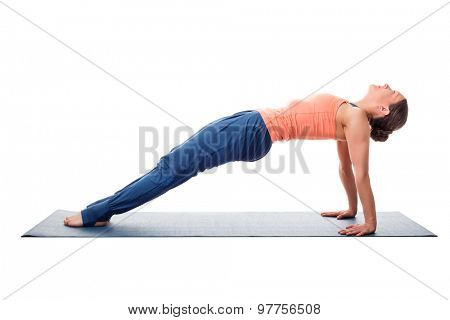 Beautiful sporty fit yogini woman practices yoga asana purvottanasana - upward-facing plank full pose isolated on white background
