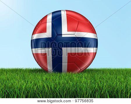 Soccer football with Norwegian flag on grass