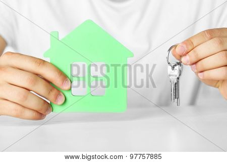 Male hands with house and keys, closeup