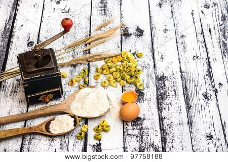 tortellini and other products on textured wooden table