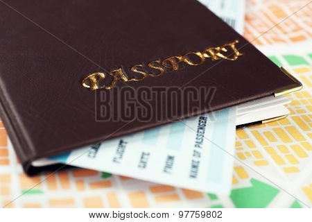 Passport with ticket on map background