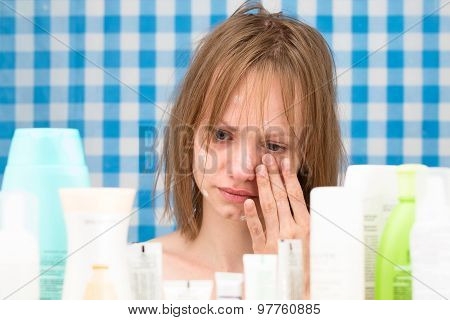 Girl Is Weeping In Bathroom In Front Of Cosmetic Products
