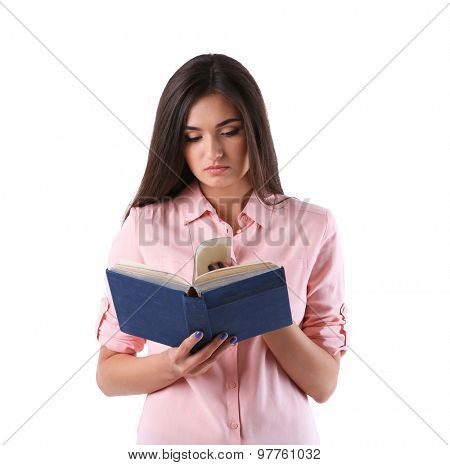 Young girl with book isolated on white