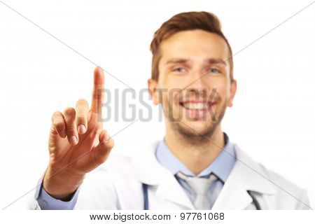 Doctor pointing his finger up isolated on white