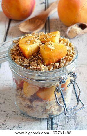 Peach granola overnight breakfast oats on white wood