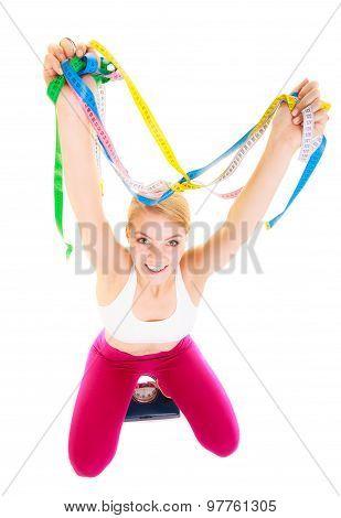 Joyful Woman On Weighing Scale. Slimming Diet.