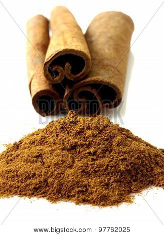 Cinnamon with chocolate and coffee beans isolated