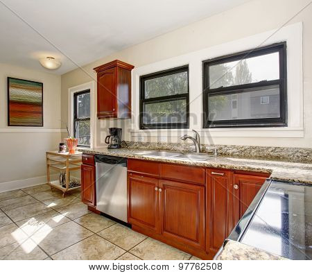 Well Defined Kitchen With Large Tile Floor.
