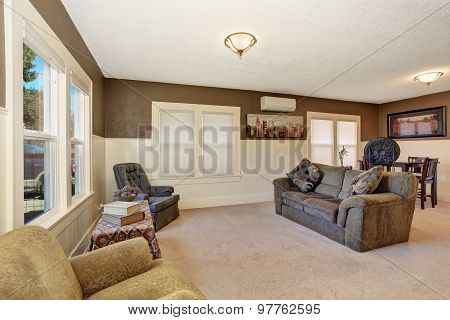 Simple Secondary Living Room With Gray Sofa.
