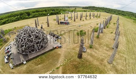 RUSSIA, NICOLA-LENIVETS - JUL 5, 2014: Visitors are near art object Universal Mind during 9 International Festival of landscape objects Archstoyanie. Aerial view. (Photo with noise from action camera)