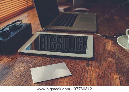 Hipster office workplace desktop lies digital tablet and laptop computer