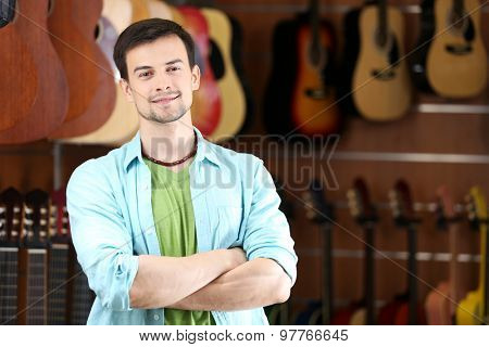 Handsome young man in music store