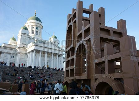 Crowd constructing cardboard skyscrapers at the Night of Arts festival in Helsinki, Finland