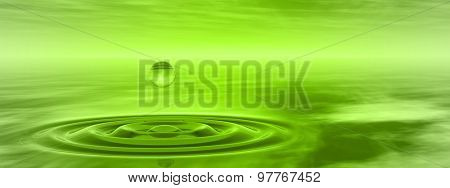 Concept or conceptual green liquid drop falling in water with ripples and waves background banner