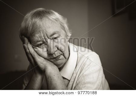 Senior woman pensive and worried. Black and white photo