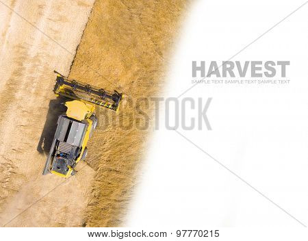 Aerial view of combine harvester on wheat field. Industrial background on agricultural theme. Picture with space for your text.