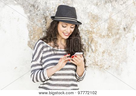 A beautiful young woman sending a text message
