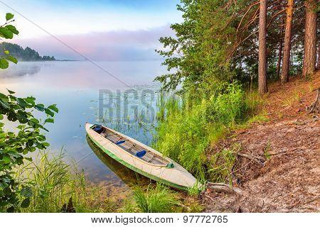 Canoe on a lake at sunrise