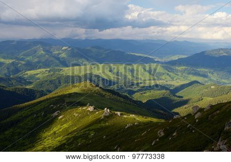 View from the mountain to the valley. Summer landscape. Carpathians, Ukraine. Europe